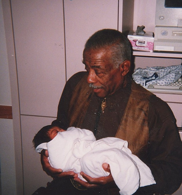 Hicey Ross Jr Holding Granddaughter Christa Loving at Hospital January 1999